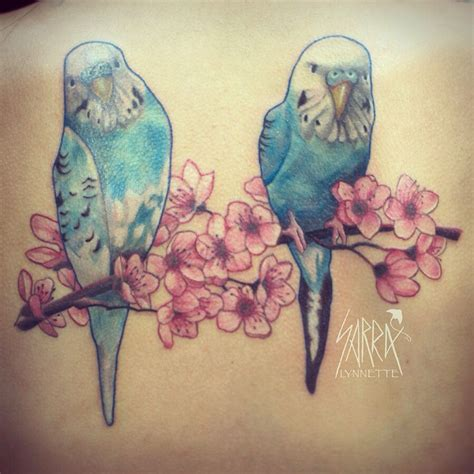 Parakeet birds on cherry blossom tree branch tattoo by